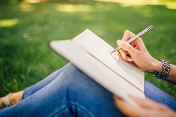 Girl-Writing-In-Garden